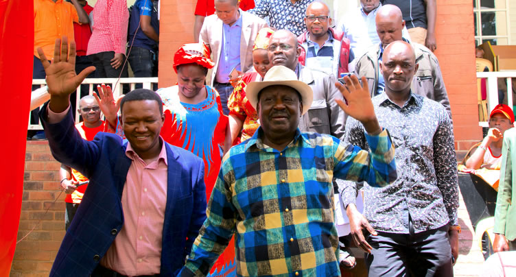 Raila Odinga and Machakos Governor Alfred Mutua arriving for a rally organised to woo Kamba voters to rally behind ODM candidate for Kibra constituency.