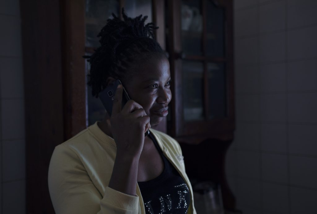 Sierra Leonean domestic worker calling relatives, after her phone was confiscated for months.