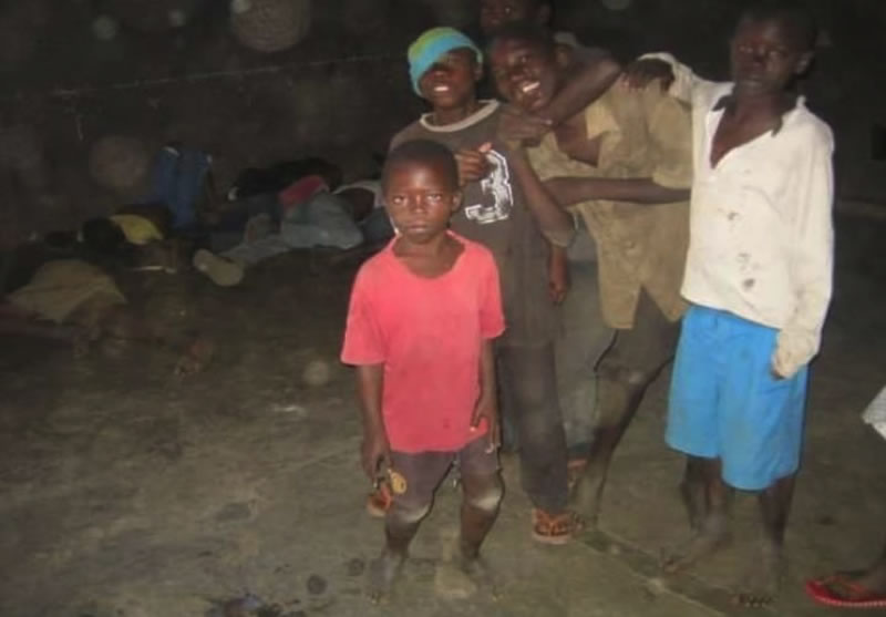 Photo of children living in the streets of Kisumu taken in 2006. Some of these children were as young as 10years. The images at the back is of group children spread out on the floor in one of the abandoned houses.