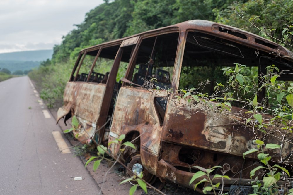 A burnt-out vehicle is seen on the road from Brazzaville to Kinkala. Credit: Philip Kleinfeld/IRIN, via The New Humanitarian