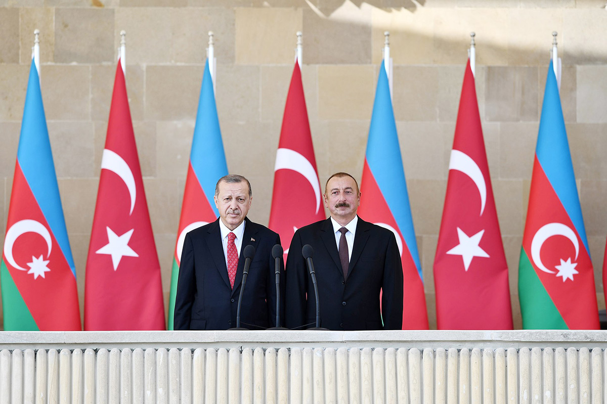 Azerbaijan's Ilham Aliyev, right, is seen with Turkish leader Recep Tayyip Erdogan at a 2018 parade in Baku. Credit: Wikimedia Commons/Government of Azerbaijan