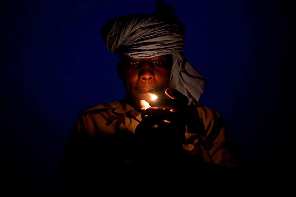 A solider lights a cigarette in Kidal, Mali. Credit: MINUSMA/Sylvain Liechti handout via REUTERS
