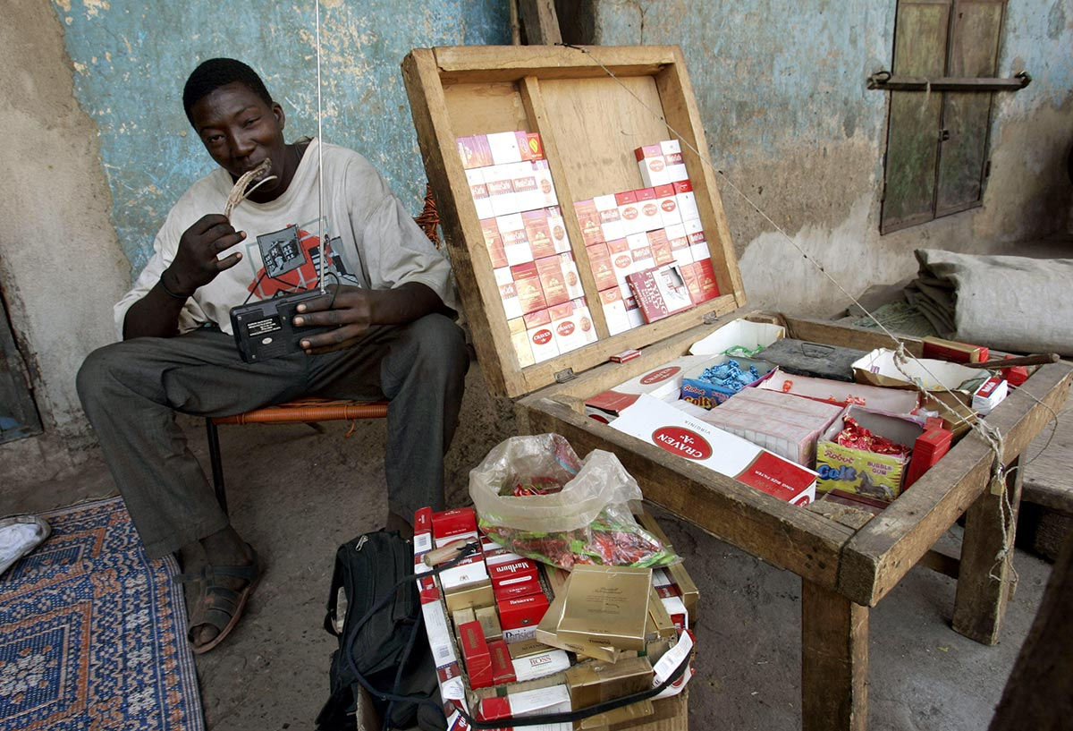 A cigarette street vendor in Mali's capital, Bamako. Credit: dpa picture alliance archive / Alamy Stock Photo