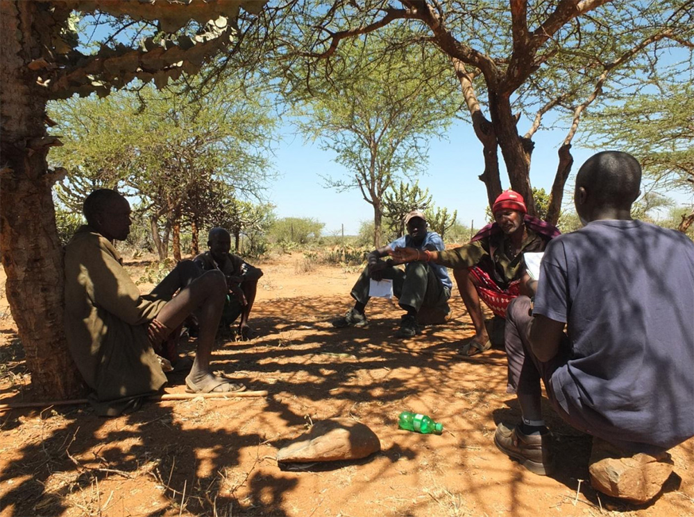 Independent researcher, Dr Mordecai Ogada, listens to herders' grievances about conservancies. Copyright M. Ogada